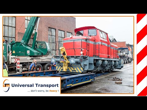 Universal Transport - locomotive transport with a flatbed trailer